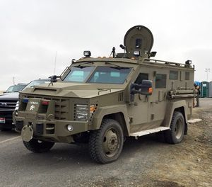 Armored vehicle known as a Bearcat blocks the road to the Malheur Wildlife Refuge at an FBI checkpoint outside of Burns, Ore., Friday, Feb. 12, 2016. (AP Photo/Rebecca Boone)