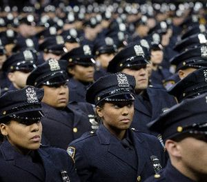 New recruits attend their a New York Police Academy graduation ceremony, Monday Dec. 29, 2014, at Madison Square Garden in New York. (AP Photo/John Minchillo)