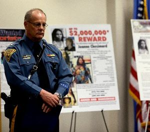 Col. Rick Fuentes, superintendent of the New Jersey State Police, stands next to posters during a news conference giving updates on the search of Joanne Chesimard, a fugitive for more than 30 years, Thursday, May 2, 2013, in Newark, N.J. (AP Photo/Julio Cortez)