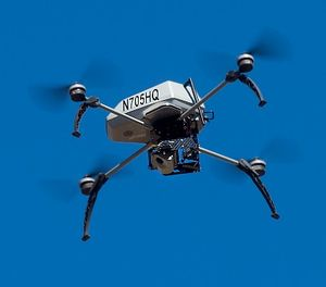 A drone operated by the Alameda County Sheriff's Office flies during a demonstration of a search and rescue operation on Friday, Aug. 14, 2015. (AP Photo/Noah Berger)