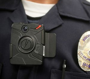 In this Jan. 15, 2014 file photo a Los Angeles Police officer wears an on-body camera during a demonstration in Los Angeles. (AP Photo/Damian Dovarganes, File)