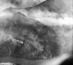 An August 1949 photo shows the scope of the Mann Gulch fire near Helena, Mont., which took the lives of 12 smokejumpers and a forest ranger when a wall of flame raced up a steep hillside. The lightning-caused blaze burned more than 3,000 acres and controlling it required the efforts of more than 400 firefighters. (AP Photo)