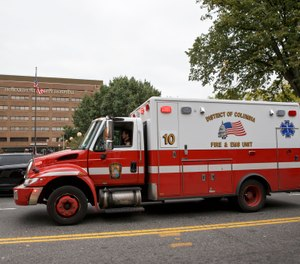 Howard University Hospital in Washington is seen Friday, Oct. 3, 2014, as a District of Columbia ambulance passes. (AP Photo/J. Scott Applewhite)