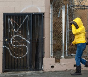A MS-13, or Mara Salvatrucha graffiti is tagged on a Salvadorean bakery wall in Los Angeles. (AP Photo/Damian Dovarganes)