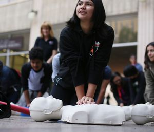 The guidelines released Tuesday said that if dispatchers know how to give instructions over the phone, they can help callers perform CPR until EMS crews arrive. (Photo/AP)