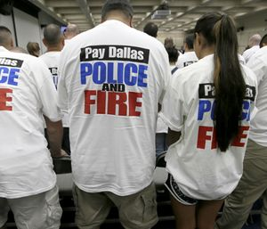 Dallas police and firefighters fill the gallery for a city council budget meeting at Dallas City Hall, Tuesday, Aug. 9, 2016, in Dallas. (AP Photo/LM Otero)