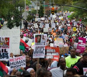 In this Aug. 23, 2014 file photo, demonstrators march to protest the death of Eric Garner in the Staten Island borough of New York. (AP Photo/John Minchillo, File)