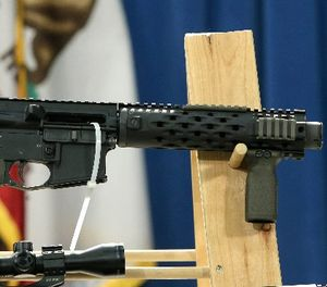 """A homemade fully automatic rifle, confiscated by the Department of Justice, is displayed at a news conference held by Sen. Kevin de Leon where he unveiled legislation dealing with so called """"ghost guns,"""" at the Capitol in Sacramento, Calif., Monday, Jan. 13, 2014. (AP Photo/Rich Pedroncelli)"""