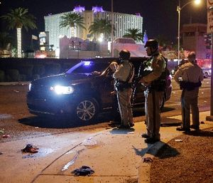 Multiple victims were being transported to hospitals after a shooting at a music festival on the Las Vegas Strip. (AP Photo/John Locher)