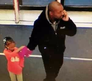 Pictured is a surveillance photo showing the child and her father. (Photo/Southfield Police Department)