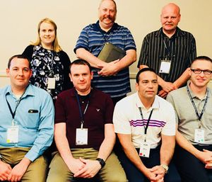 A group of students (Top row: Hailey Palmore, Charles McLeod, Mike Lindsay Bottom Row: Kevin Crocker, Mike Grimes, Dan Marshall, Ryan Strange) is conducting a study on bullying, harassment and critical stress in the EMS industry. (Photo/ASM)