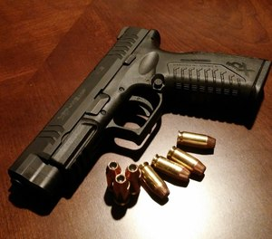 The legislation would require personnel to complete an eight-hour firearm training course and receive written permission from their supervisor before they would be allowed to carry on the job. (Photo/MaxPixel)