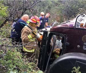 Authorities say a man trapped in his crashed vehicle on a central Arizona mountain for three days was rescued thanks to a couple taking sightseeing photos. (Kim Moore via AP)
