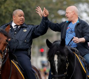 New Orleans Mayor Mitch Landrieu, right, and chief of police Michael Harrison ride on horseback at the start of the Krewe of Zulu parade on Mardi Gras day in New Orleans. A day after her first choice withdrew his candidacy, Baltimore's mayor on Tuesday, Jan. 8, 2019, picked New Orleans Police Superintendent Michael Harrison as her nominee to lead the city's troubled force. (AP Photo/Gerald Herbert, File)