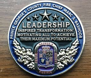 """The saying Chief Bashoor chose to be engraved on his personal challenge coin says – """"Leadership inspires transformation: Motivating all to achieve their maximum potential."""" (Courtesy photo)"""