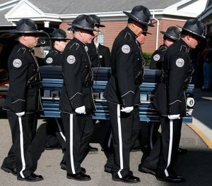 Members of the Biloxi Police Department Honor Guard escort the body of officer Robert McKeithen, into the First Baptist Church of Biloxi, Miss., Monday, May 13, 2019, for visitation. (AP Photo/Rogelio V. Solis)