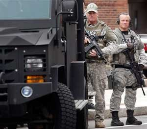 "Armored vehicles and other so-called ""militarized"" looking equipment is essential to missions such as responding to violent crimes in progress like armed robberies and active-shooter incidents, barricaded subjects, hostage situations, as well as for searching for suspects like Dzhokhar and Tamerlan Tsarnaev, which is exactly what the officers pictured above were doing when this image was taken. (AP Photo)"