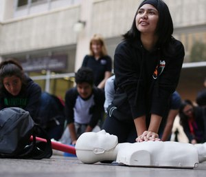 Thousands attending the ECCU conference marched in downtown San Diego to focus attention on the need for more CPR training and AEDs across the U.S. to help reduce deaths form sudden cardiac arrest, Thursday, Dec. 10, 2015.  (Sandy Huffaker/AP Images for Citizen CPR Foundation)