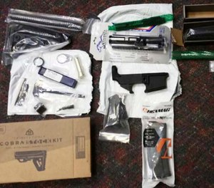 This undated photo provided by the Office of Attorney General of New Jersey shows parts of guns confiscated after being sold by mail order from a California company. (Office of Attorney General of New Jersey via AP)
