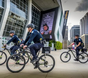 Sacramento, Calif., police officers ride bicycles near the Golden 1 Center (Hector Amezcua/Sacramento Bee via AP, File)