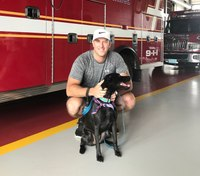 Photo of the Week: Firefighter takes in patient's dog
