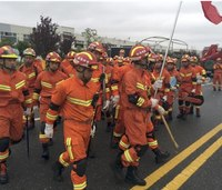 Firefighters, USAR search rubble after tornado kills 98 in China