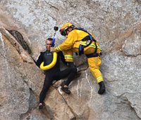 Man rescued from cliff in marriage proposal stunt arrested