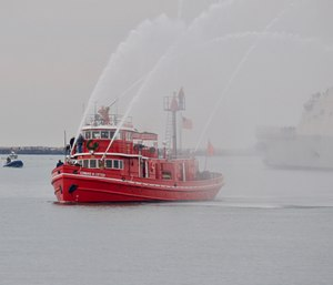 The fire-engine red Edward M. Cotter — believed to be the oldest active fireboat in the world — has been putting out fires and breaking up ice for 118 years. (Photo/Wikimedia Commons)