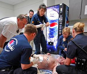 EMS providers assist a patient (image/iStock)