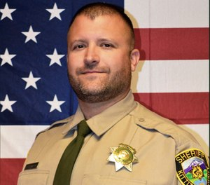 Deputy Ryan Thompson. Thompson, 42, was shot and killed and a police officer was wounded after they exchanged gunfire with a road rage driving suspect Tuesday, March 19, 2019 (Kittitas County Sheriff's Office via AP)