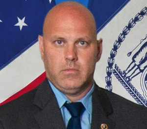 Det. Brian Simonsen is shown. New York Police Commissioner James O'Neill told the media during a news conference that Simonsen was shot and killed by friendly fire Tuesday night, Feb. 12, 2019, while responding to a report of an armed robbery at a T-Mobile store in the Richmond Hill section of Queens. (New York City Police Department via AP)