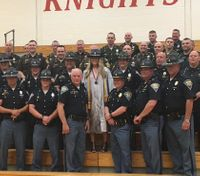 Police across Ind. gather to support daughter of slain LEO at graduation