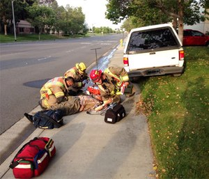 Paramedics attend a diabetic man who lost control of his vehicle due to hypoglycemia. (Photo by Sbharris - Wikipedia commons own work, CC BY-SA 3.0)