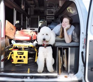 Eight years ago, if someone had told Lauren Christie – a college graduate with a degree in business administration and marketing – that one day she would spearhead an EMS therapy dog program, she probably wouldn't have believed it herself. (Photo/AMR's Therapy Dog Team Facebook)