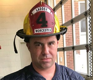"""Worcester EMS paramedic Sean Doherty penned """"December Mourn"""" to remember Worcester Fire Department firefighter Christopher Roy. (Photo/WFD)"""