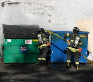 Whether the fire is in a residential trash receptacle or a large commercial dumpster, firefighters need to have a constant approach to these incidents. (Photo/Wikimedia Commons)
