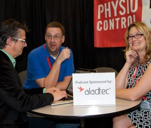 Scott Kier, center, discusses paramedic best practices with Chris Montera and Anne Montera at an EMS conference. (Image Scott Kier)