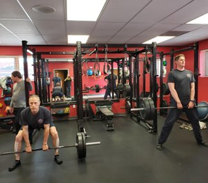 Modern and appropriate equipment for the station should include cardiovascular machines, functional training equipment (racks, bumper plates, bars, hex bars) kettlebells, dumbbells and the assorted exercise straps and bands necessary for firefighter fitness. (Photo/Bryan Fass)