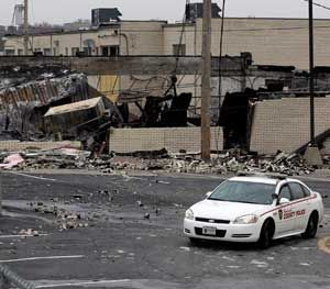 On West Florissant in Ferguson, buildings were burned to the ground when word came down that a grand jury would not indict Darren Wilson. (AP Photo)