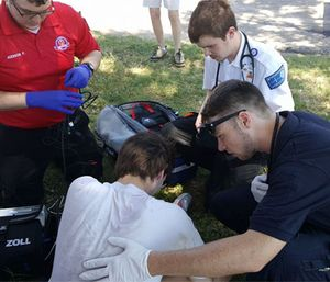 Paramedic students assess a patient during Hutchinson Field Ops program. (Image courtesy Facebook Kingman EMS)