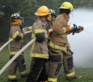 Evaluate team integrity, communication and progress while advancing the hose line to complete a primary search. (Photo/Max Pixel)