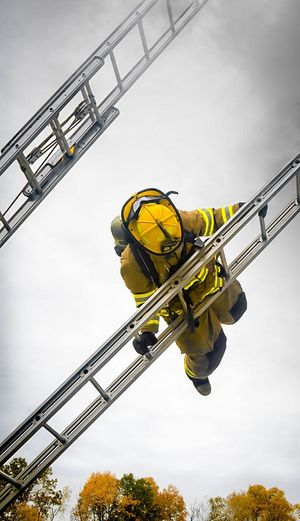 Firefighter doing a ladder slide (Photo/Pixabay)