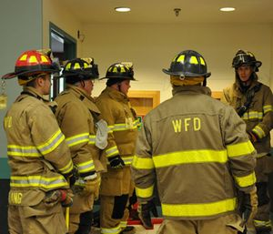As a firefighter progresses in their training and gain confidence in the technique, perhaps the safety line can then be removed to duplicate the conditions and setup of a real sublevel rescue. (Photo/Windsor (Vt.) Fire Department)