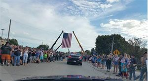 Officers in charge of traffic control didn't need to do much. The mammoth crowds shut everything down lining the streets 10 to 20 people deep for miles. It was like a massive Fourth of July parade, but everyone was crying.  (Photo Courtesy of Officer Dusty Nichols)