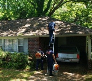 They returned to the residence and removed limbs and leaves from the roof, trimmed the hedges, edged the driveway and blew the leaves from the yard and driveway. (Photo/ Gainesville Fire Department)