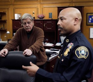 Detroit Police Chief Ralph Godbee (right) and author George Kelling (left), are interviewed in Detroit in 2012. (AP Photo/Carlos Osorio)