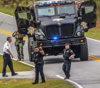 2 officers wounded in Ga. standoff that killed 3 people
