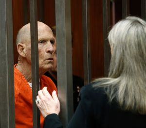 Joseph James DeAngelo, suspected of being the Golden State Killer, talks with his attorney, Diane Howard, in Sacramento County Superior Court after prosecutors announced they will seek the death penalty if he is convicted in his case, Wednesday, April 10, 2019, in Sacramento, Calif. (AP Photo/Rich Pedroncelli)