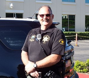 Deputy Chet Parker stands in front of his vehicle (Image/Chet Parker)