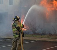 When to use a large fire hose line for advanced conditions